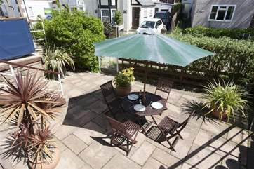 Pretty little patio below the balcony, a real sun trap for enjoying family meals