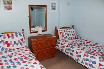 Pretty nautical feel to the twin bedroom