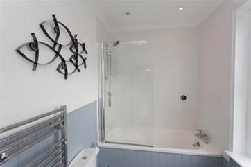 Nautical feel to the family bathroom with shower over the bath