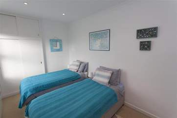 The twin bedroom is lovely and light, the colour scheme flows with the setting