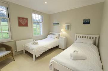 The twin bedroom overlooks the tennis courts and is a peaceful room to relax in