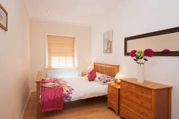 For a good night's sleep, the second bedroom is a delightful space with a comfortable double bed