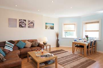 The open plan living room/dining room is a modern and well decorated space boasting spectacular views, plenty of light and a calm feel throughout