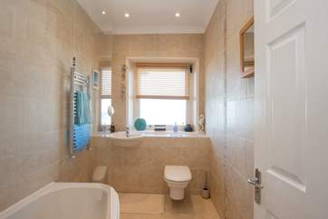 With a fitted shower over the bath, there is the choice of a quick morning shower, or a long evening soak in a bubble bath
