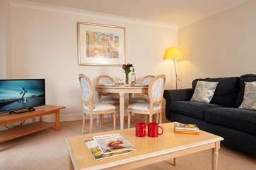A table and chairs in the sitting room are a perfect spot for games nights and casual family meals.