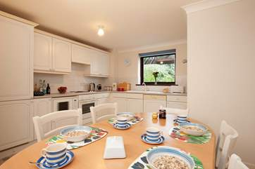It's a good sized kitchen that will accomodate the whole family.