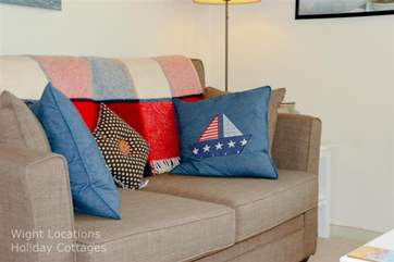 Comfortable seating with a cosy blanket to snuggle under while watching TV.