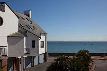 The quiet seafront location an easy walk away from the centre of the Village