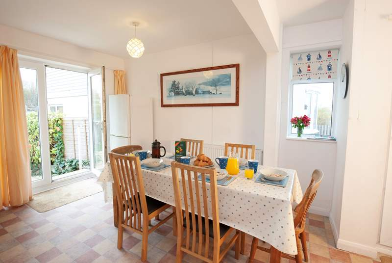 You enter the property and are greeted by a bright kitchen and dining area.