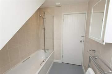 Family bathroom with overhead shower
