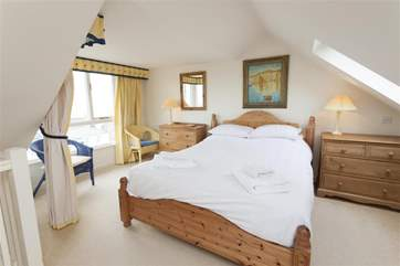 Lovely light double bedroom in the loft space on second floor
