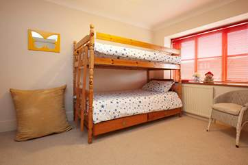 As well as cheerful bunk room.