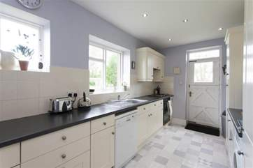 Large fully equipped kitchen with door out to large lawned garden