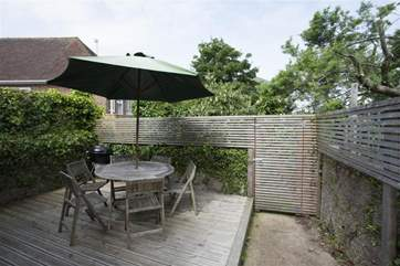 Raised decking area in the enclosed rear garden