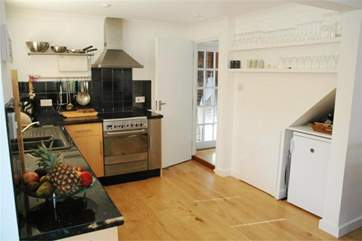 The kitchen is both modern and fully equipped