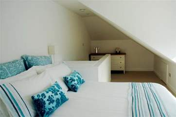 The main bedroom is in the eaves on the second floor; lovely, sunny and spacious