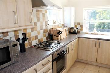 The kitchen is fully equipped and modern