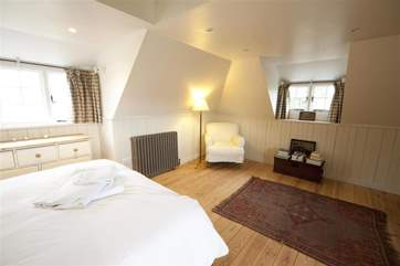 The bedroom is lovely and large with views across the garden