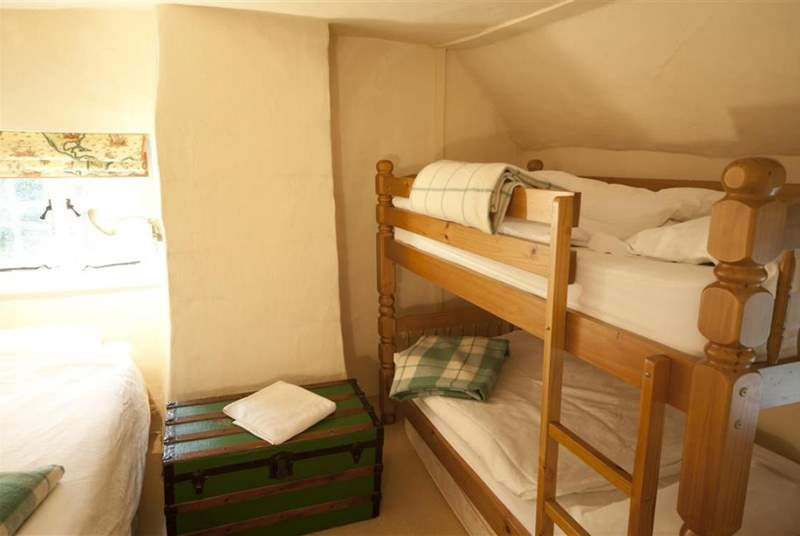 Family bedroom with bunk beds and a day bed