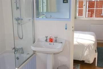 Jack & Jill bathroom has a shower over the bath