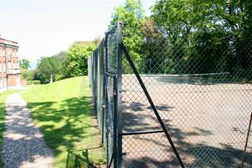 Enjoy a game of tennis in the grounds, but make sure you book your time slot