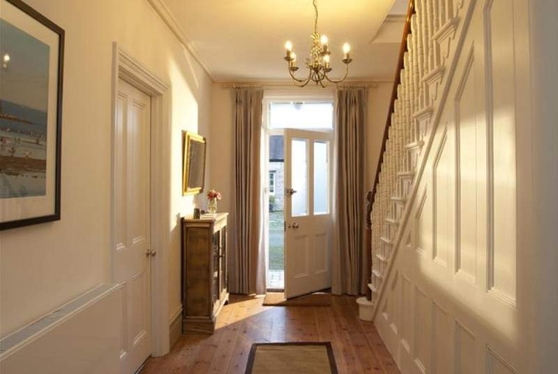 The entrance hall is just off the utility/boot-room with doors to all downstairs rooms.