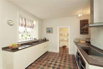 The farmhouse kitchen is both modern and superbly equipped.