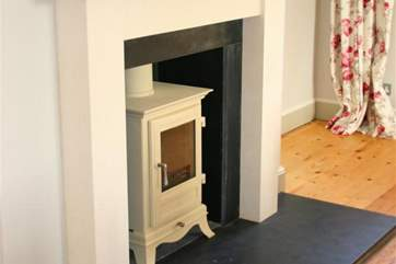 The pretty woodburning stove in the dining-room.