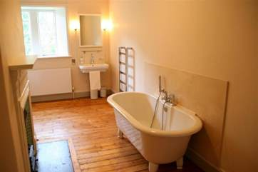 And another bathroom with a mix of modern and traditional features.