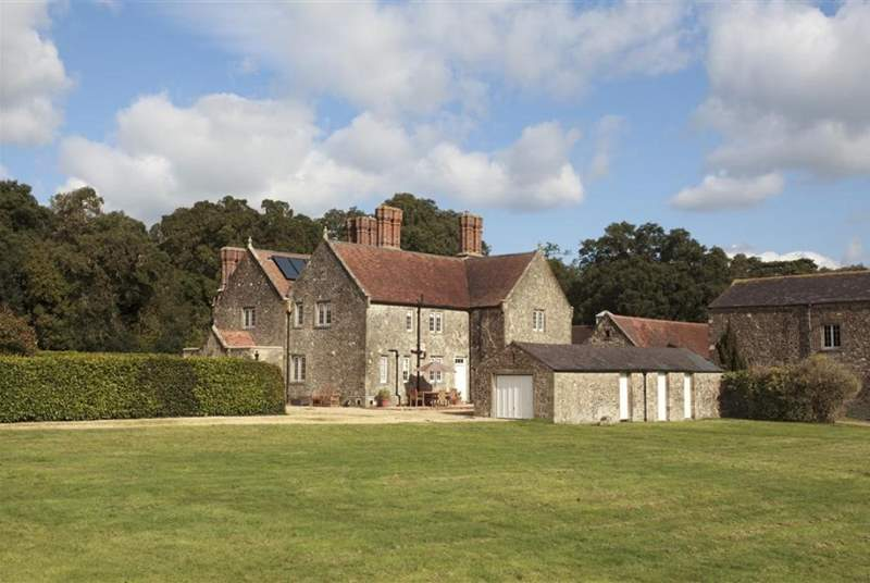 The gravelled driveway leads to the large parking area to the front of Barton Manor Farmhouse