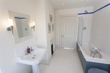 Second bathroom with shower over bath