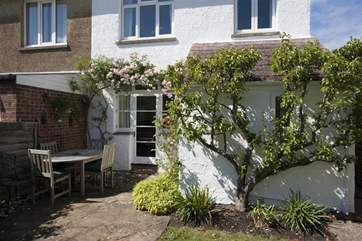 The pretty rear garden is a sun trap and safe for the children to run around in