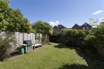As the sun sets, enjoy a BBQ in the fully enclosed garden
