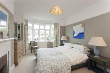 The master bedroom overlooks Fairy Road and has a lovely feature fireplace