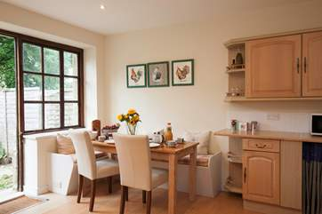 The open plan kitchen/dining area is a great spce for eneteraining whilst cooking up a treat