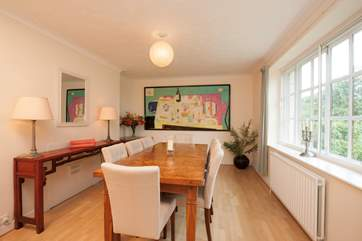 The lovely dining room has a large dining-table with seating for eight