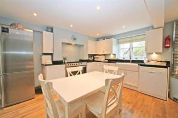 The large kitchen is both modern and fully equipped