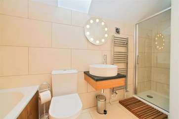 Lovely modern bathroom with walk in shower on the first floor