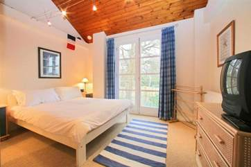 King size bedroom on the first floor with views towards the creek
