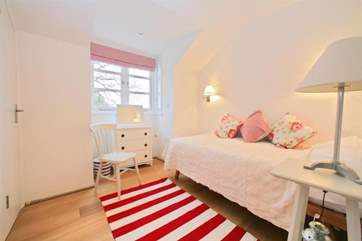 A room fit for a princess. The pretty single bedroom on the first floor
