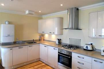 A beautiful and modern kitchen well equipped with everything you will need