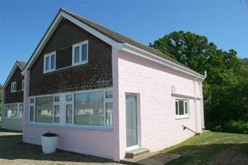 Curlew Cottage is located at the rear of the Salterns Village development, a short walk from the seafront