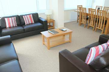 The open plan living area was recently refurbished with new furniture and provides ample seating for a large group.