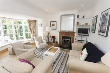 Rest up in the cosy living room with plenty of seating for all.