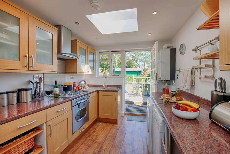 The kitchen is light and airy, and opens through to the Garden