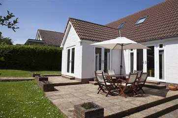 Large patio area with garden furniture