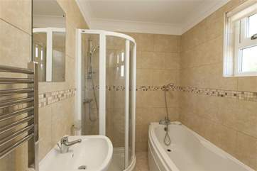 Family bathroom with shower over bath and separate shower cubicle