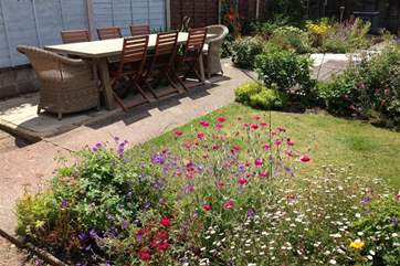 Rear garden with outside dining furniture
