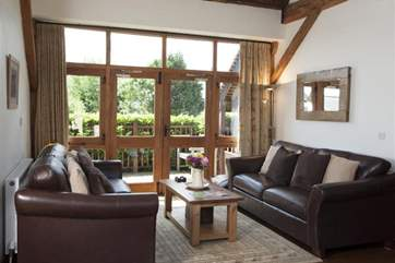 Living area with patio doors and soft seating