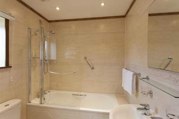 Ensuite bathroomwith shower over bath
